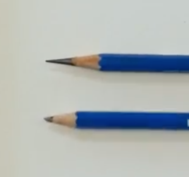 Pencil on top was sharpened with long point sharpener, pencil on bottom sharpened with regular sharpener